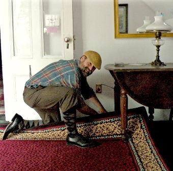 John spreading an area carpet at the Unitarian Universalist Meetnghouse in Provincetown, MA